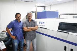 L–R: Anil Namugade & Milind Deshpande, Managing Partners of Trigon Digital Solutions along with the Epson SurePress L-4033AW in Mumbai