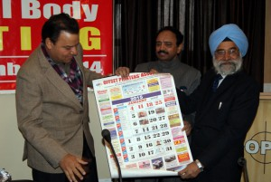 The annual calendar of OPA being released by Shri S S Dhillon and Parveen Aggarwal